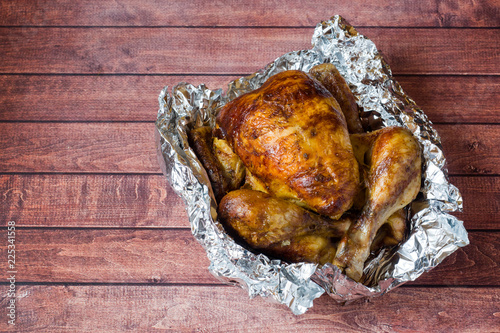 Foto op Canvas Kip Heavily roasted grilled Chicken on wooden background