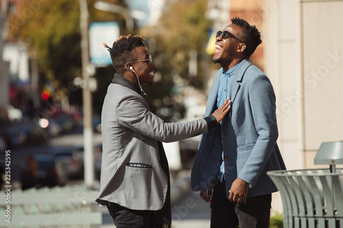 Fotografie, Obraz  Two young african businessmen friends talking on the street