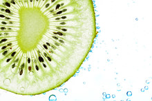 Sliced Kiwi Covered With Bubbles