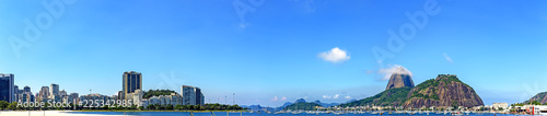 Wall Murals Rio de Janeiro Panoramic morning view of the beach and Botafogo cove with its buildings, Sugar Loaf hill, boats and mountains in Rio de Janeiro