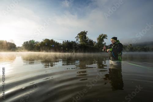 Printed kitchen splashbacks Fishing Man fishing in river with fly rod during summer morning.