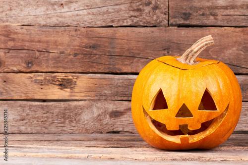 Funny Halloween pumpkin on wooden background Tableau sur Toile