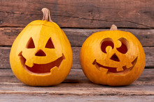 Halloween Pumpkins On Wooden Background. Pumpkins For Traditional Autumn Holiday. Funny Pumpkin Carving.