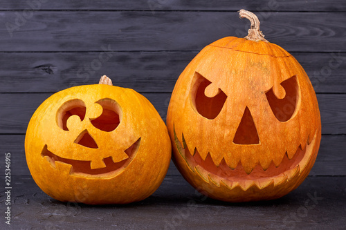 Two Halloween Pumpkins On Wooden Background Funny And Angry