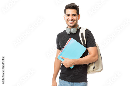 Fotografia Smiling Young College Student With Books And Backpack
