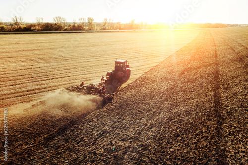 Fotografie, Obraz  Agriculture machine harvesting crop in fields