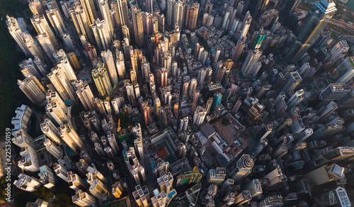 Photo Stands New York Aerial view of Hong Kong Downtown. Financial district and business centers in smart city in Asia. Top view of skyscraper and high-rise buildings.