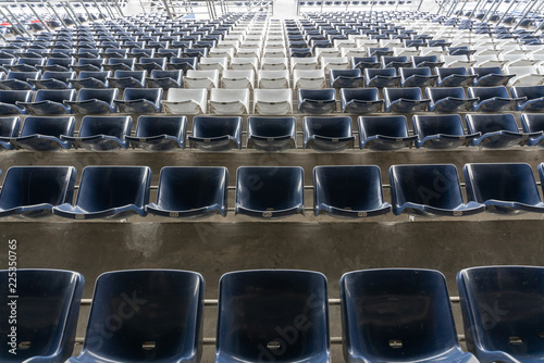 Foto auf Leinwand Stadion empty Rows of stadium grandstand seats or stadium seats, plastic blue and white seats on grand stadium pattern.