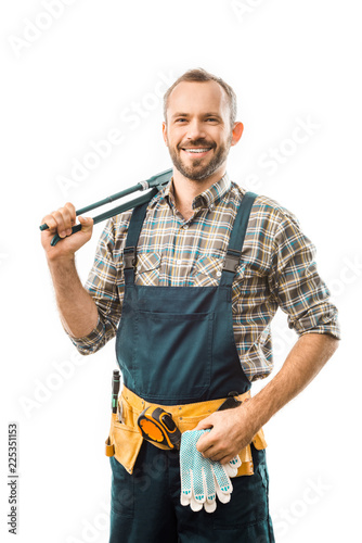 Fotografía  smiling plumber with tool belt holding monkey wrench and looking at camera isola