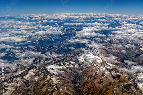 Foto op Plexiglas Luchtfoto Alps mountains aerial view from airplane snow