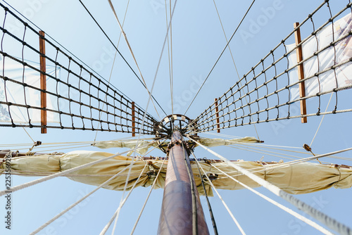 Fotografie, Obraz  Mainmast and rope ladders to hold the sails of a sailboat.
