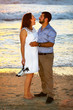 Romantic couple embracing at the beach
