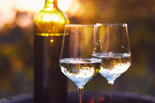 Two Glasses Of White Wine At Sunset