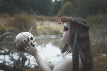 Creepy Dead Bride With Human Skull Outdoor. Halloween Scene