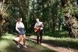 young couple walking in the forest, playing guitar and dancing, summer nature, bright sunlight, shadows and green leaves, romantic feelings