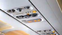 Closeup Image Of Air Conditioner Holes And And Individual Lights Over The Passenger Seat Of Aircraft