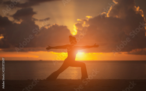 Fototapety, obrazy: Yoga on the beach Silhouette style.