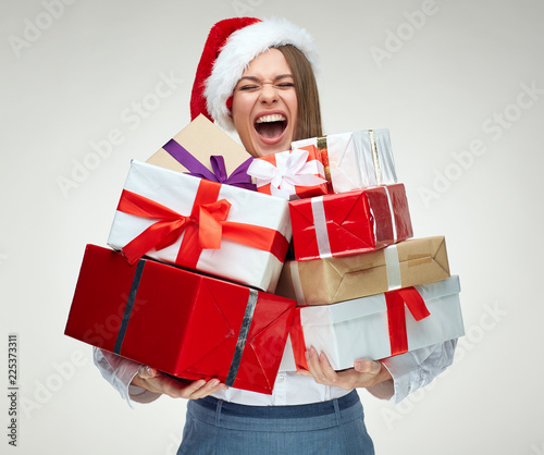 Papiers peints Akt Happy woman wearing santa hat holding pile of gifts.