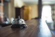 Restaurant Service Bell on the Table in Hotel Reception - Vintage with Bokeh, Daylight Background