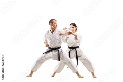karate girl and boy fighting against white background