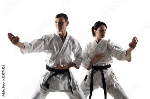 karate girl and boy posing against white background