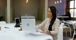 Female executive using laptop 4k