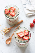 Overnight Oatmeal Or Strawberry Overnight Oats In A Jar On Concrete Background. Selective Focus, Healthy Eating And Lifestyle Concept