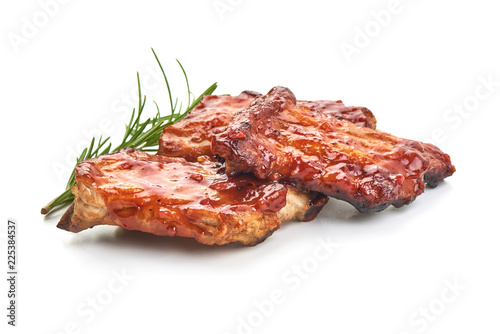 Cuadros en Lienzo Delicious grilled pork ribs in BBQ sauce with herbs, isolated on white background