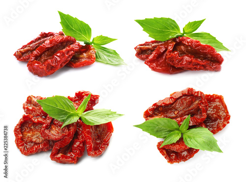 Set with sun dried tomatoes and basil on white background