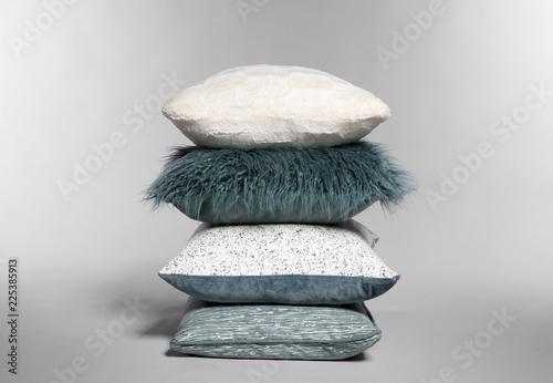 Fotografie, Obraz  Stylish decorative pillows stacked on light background