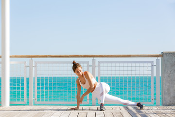 Woman stretching on terrace