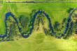 Leinwandbild Motiv Aerial view on winding river in rural landscape