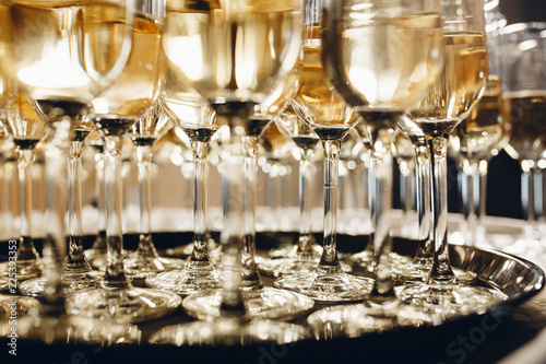 Champagne glasses on gold background. Party and holiday celebration concept.