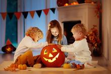 Kids Carving Pumpkin On Hallow...