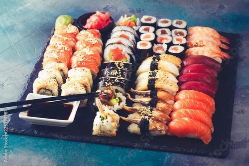 Photo  Japanese sushi big set with pair of black chopsticks, toned
