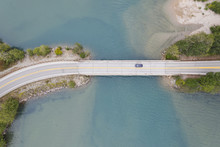 Aerial View Of A Road Bridge Over A Lake In Washington State, USA