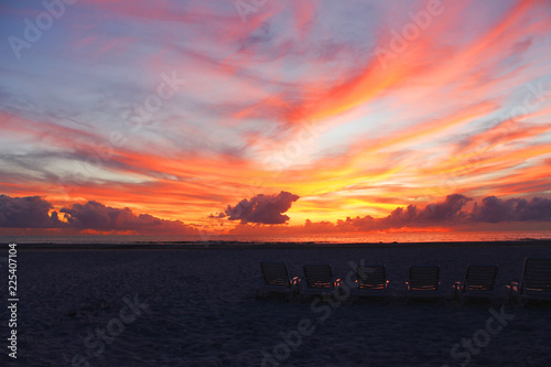 Photo Sunset with beach chairs, St. Pete Beach, Florida