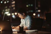Businessman Working At His Desk At Night