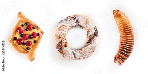 Fotografie, Obraz  Fresh and tasty berry cake, a pretzel with sugar powder and banana in dough isol