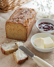 A Loaf Of Home Made Paleo Bread With Butter And Jam.