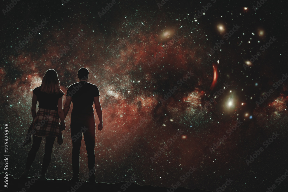 Fototapety, obrazy: The silhouette of a lovers pair who looks at the night sky. A conceptual illustration of the silhouettes of people watching the cosmos. Boy and girl holding hands looking at the stars.