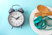 Time To Lose Weight , Eating Control Or Time To Diet Concept , A Alarm Clock With  Healthy Tool Concept Decoration On Blue Background