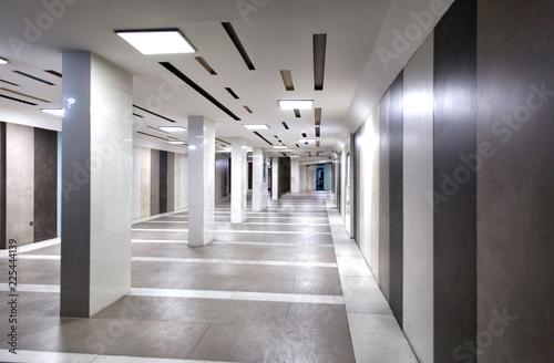 Fényképezés  Wide underground passage with granite trim