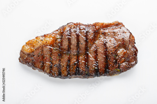 Garden Poster Steakhouse grilled marbled beef steak striploin isolated on white background, top view