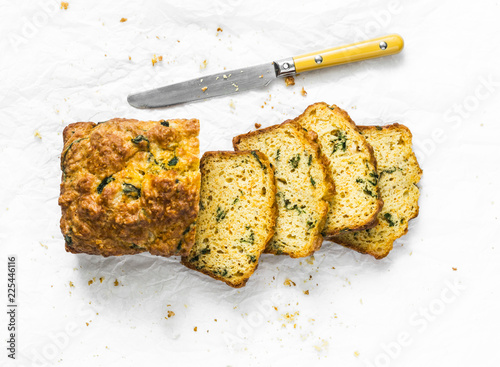 Fotografie, Obraz  Savory spinach, cheddar cheese and pumpkin loaf on a light background, top view