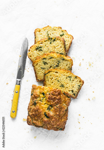 Stampa su Tela Savory spinach, feta and squash loaf on a light background, top view