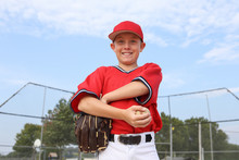 Boy Pitcher Smiling And Holding A Baseball