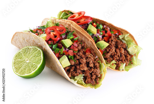 Mexican tacos with beef, tomatoes, avocado, chilli and onions isolated on white background.