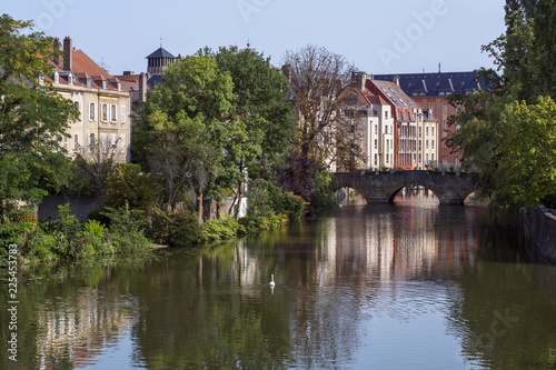 Wall Murals Bridges French river in Metz in France in the summer day with some classic houses on the banks