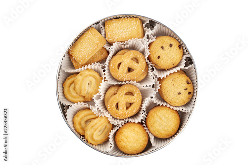 An overhead photo of Danish butter cookies in the traditional tin box, isolated on a white background with a clipping path